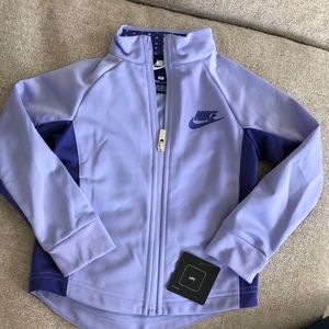 Toddler girls Nike zip up purple jacket. Size 2T.